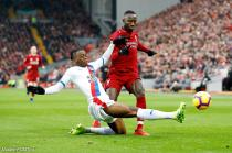 Crystal Palace's Aaron Wan-Bissaka (left) and Liverpool's Naby Keita battle for the ball  during the Premier League match between Liverpool and Crystal Palace on 19th January 2019.
